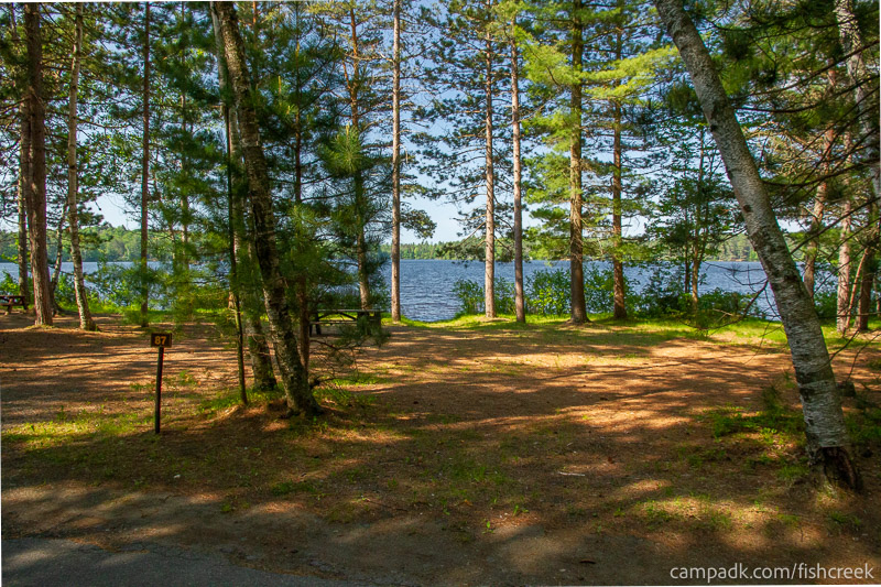 Campsite Photo of Site 87 at Fish Creek Pond Campground, New York - Looking at Site from Road Sign Visible