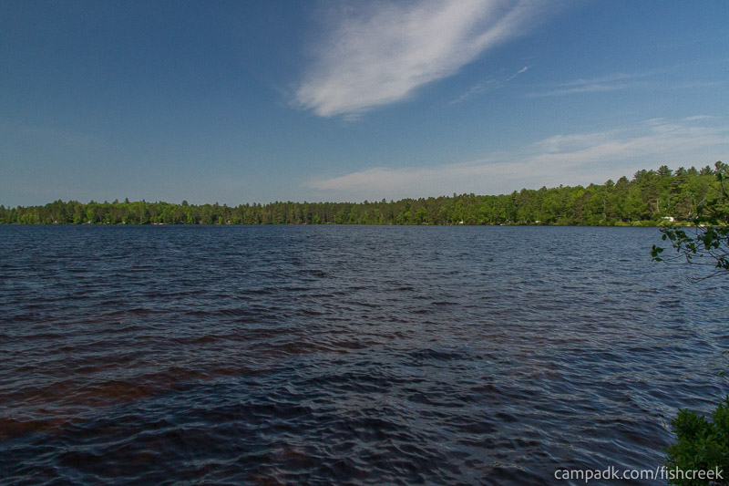 Campsite Photo of Site 87 at Fish Creek Pond Campground, New York - View from Shoreline
