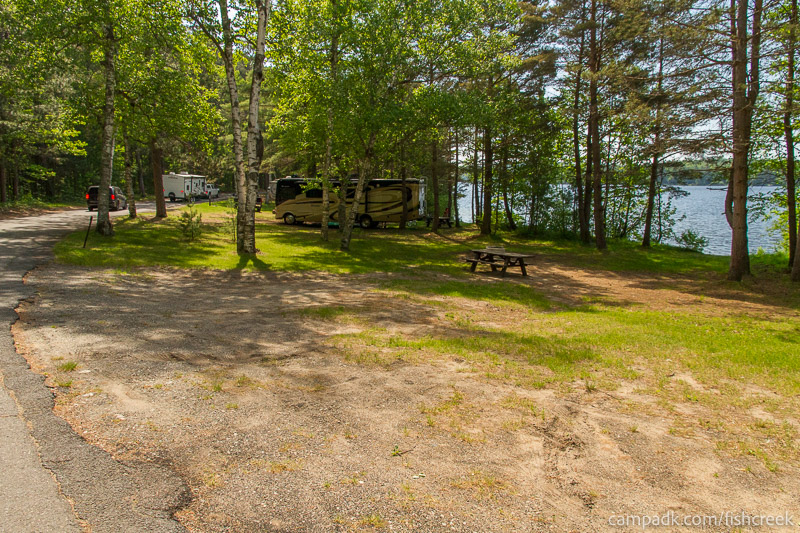 Campsite Photo of Site 99 at Fish Creek Pond Campground, New York - Looking at Site from Road