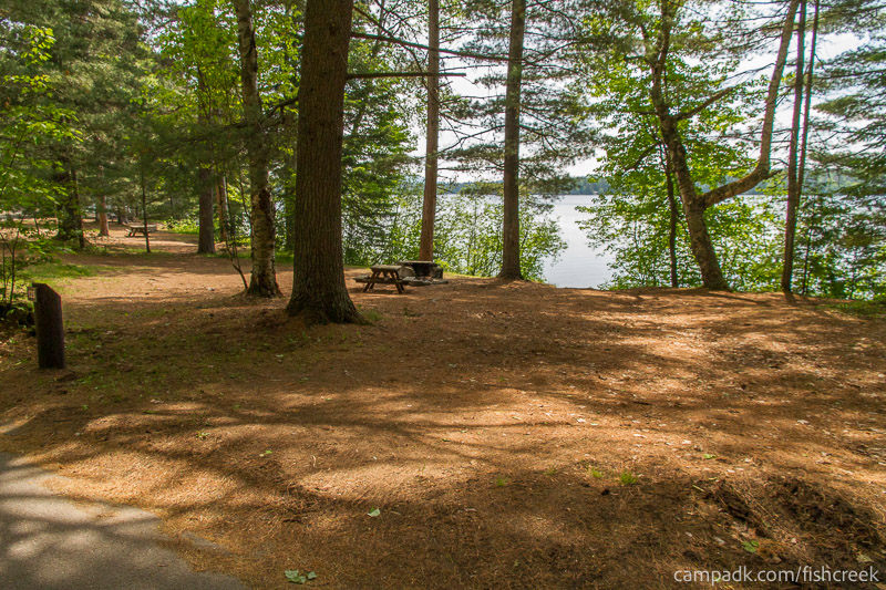 Campsite Photo of Site 125 at Fish Creek Pond Campground, New York - Looking at Site from Road Sign Visible