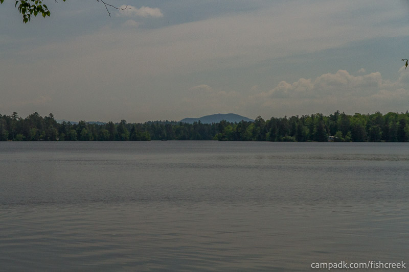 Campsite Photo of Site 138 at Fish Creek Pond Campground, New York - View from Shoreline