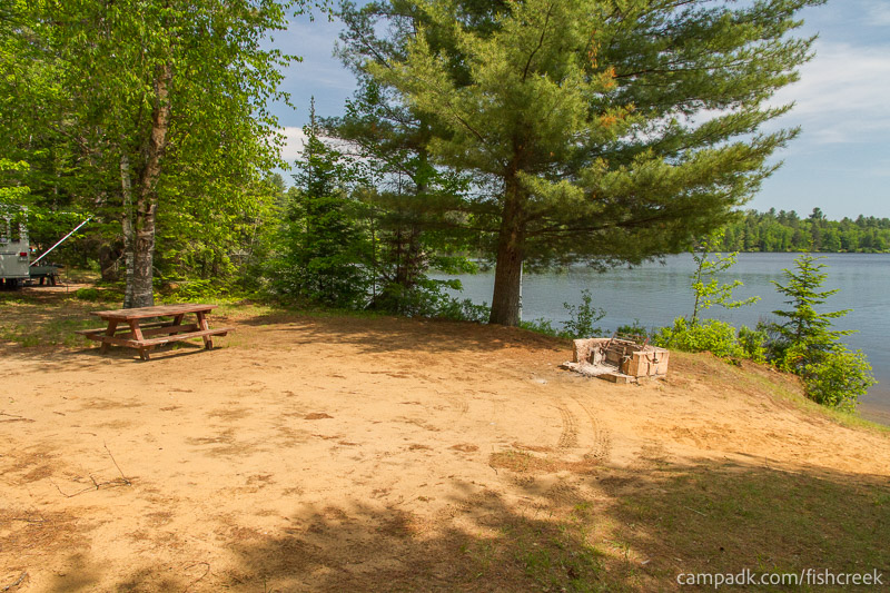 Campsite Photo of Site 143 at Fish Creek Pond Campground, New York - Cross Site View