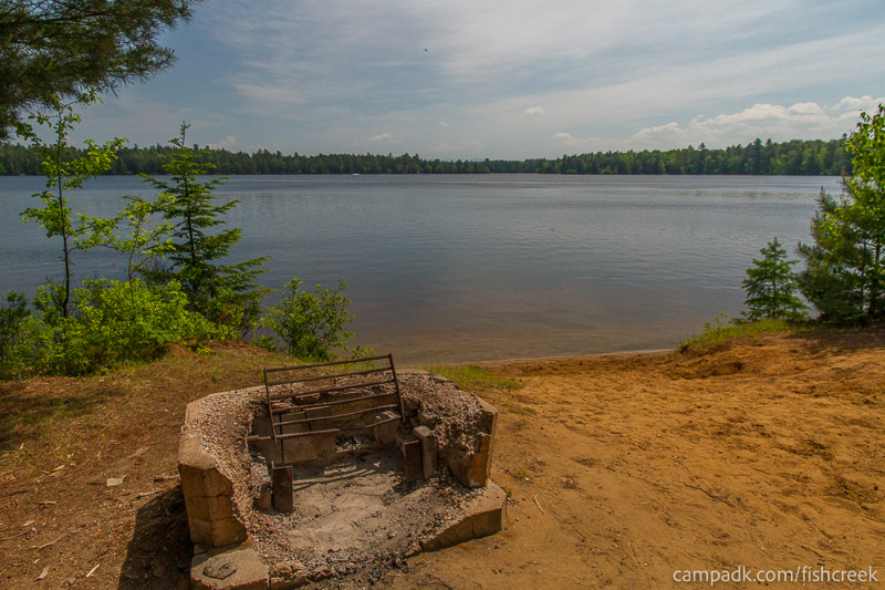 Campsite Photo of Site 143 at Fish Creek Pond Campground, New York - Fireplace View