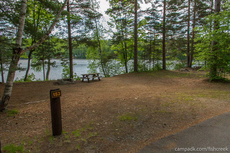 Campsite Photo of Site 153 at Fish Creek Pond Campground, New York - Looking at Site from Road Sign Visible