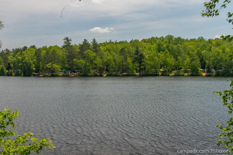 Campsite Photo of Site 153 at Fish Creek Pond Campground, New York - View from Shoreline