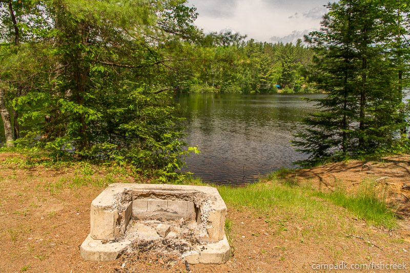 Campsite Photo of Site 170 at Fish Creek Pond Campground, New York - Fireplace View