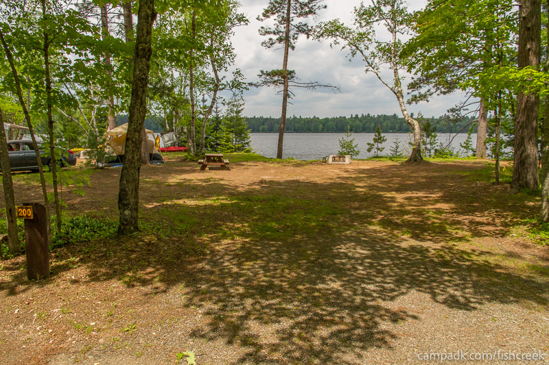 Campsite Photo of Site 200 at Fish Creek Pond Campground, New York - Looking at Site from Road Sign Visible