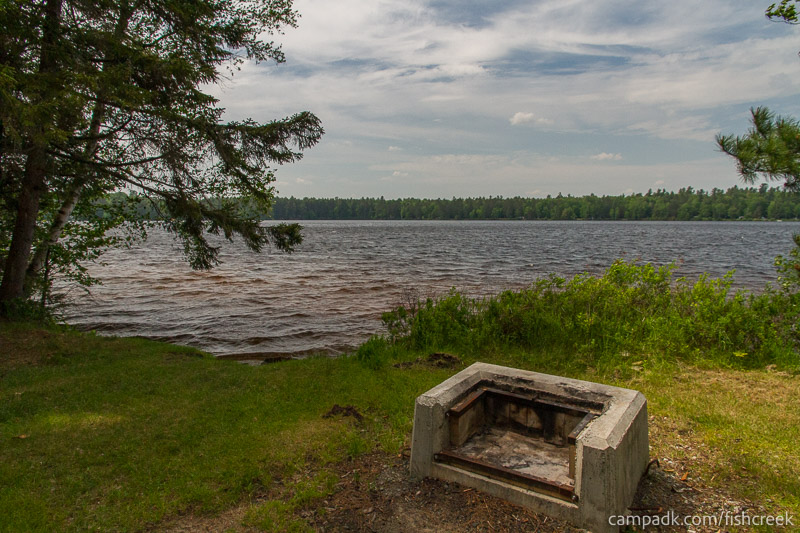 Campsite Photo of Site 217 at Fish Creek Pond Campground, New York - Fireplace View