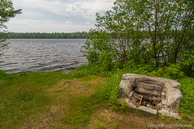 Campsite Photo of Site 218 at Fish Creek Pond Campground, New York - Fireplace View