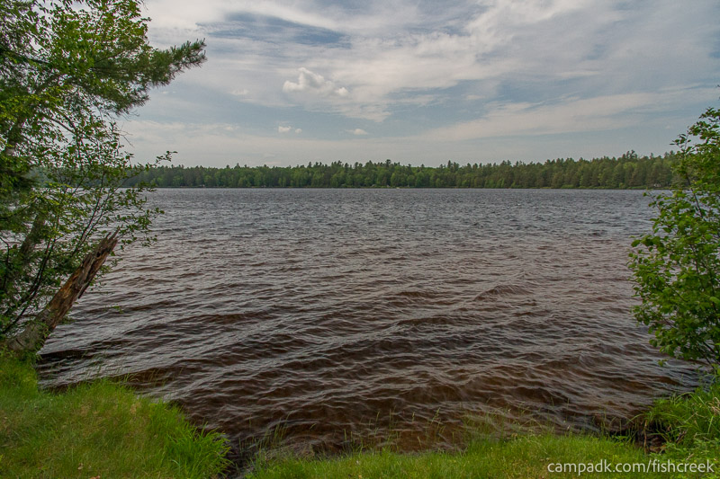 Campsite Photo of Site 218 at Fish Creek Pond Campground, New York - View from Shoreline