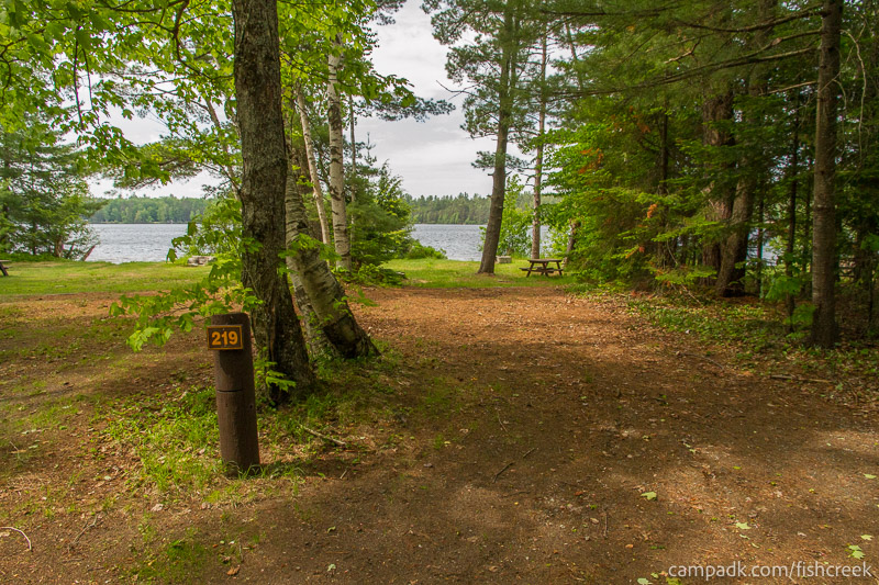 Campsite Photo of Site 219 at Fish Creek Pond Campground, New York - Looking at Site from Road Sign Visible