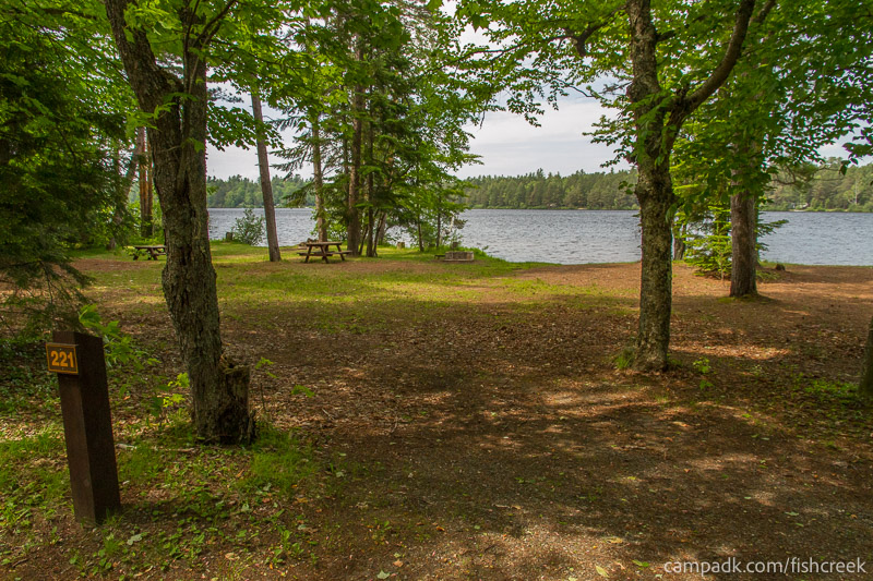 Campsite Photo of Site 221 at Fish Creek Pond Campground, New York - Looking at Site from Road Sign Visible