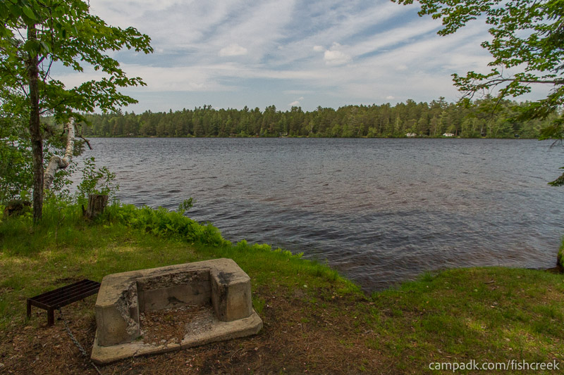Campsite Photo of Site 221 at Fish Creek Pond Campground, New York - Fireplace View
