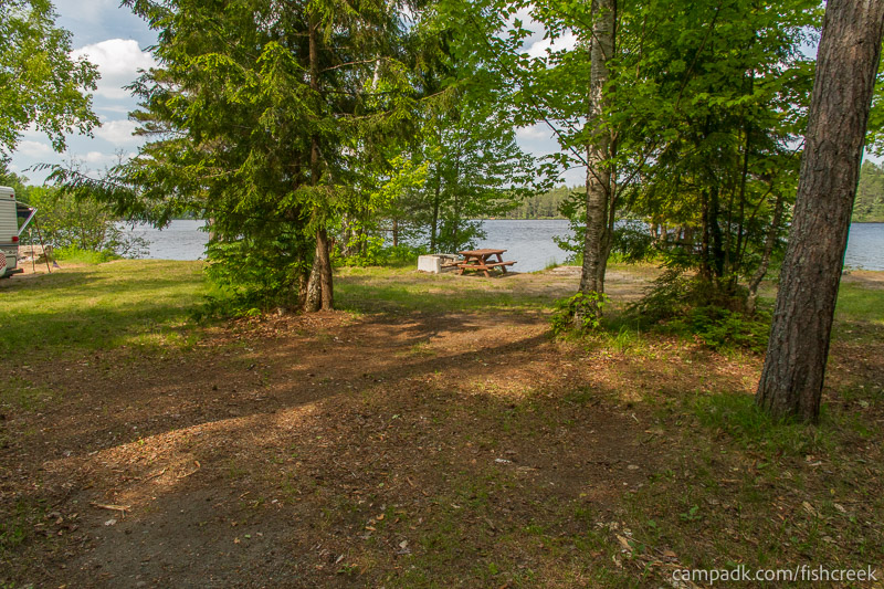 Campsite Photo of Site 240 at Fish Creek Pond Campground, New York - Looking at Site from Road