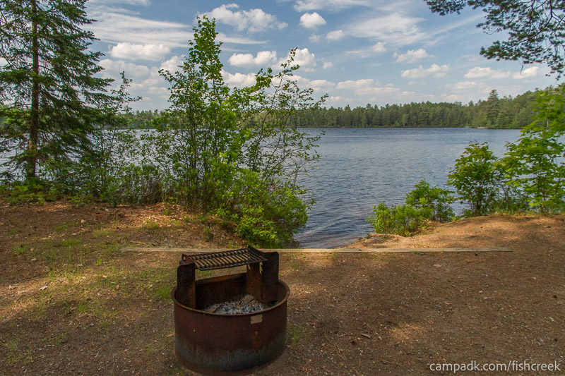 Campsite Photo of Site 244 at Fish Creek Pond Campground, New York - Fireplace View