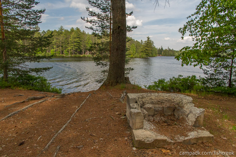 Campsite Photo of Site 251 at Fish Creek Pond Campground, New York - Fireplace View