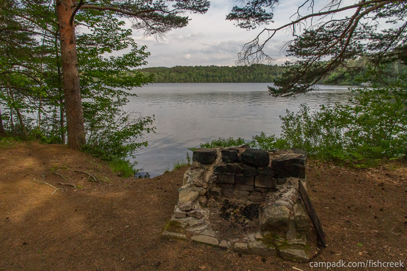 Campsite Photo of Site 260 at Fish Creek Pond Campground, New York - Fireplace View