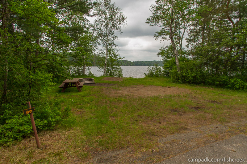Campsite Photo of Site 69 at Fish Creek Pond Campground, New York - Looking at Site from Road Sign Visible