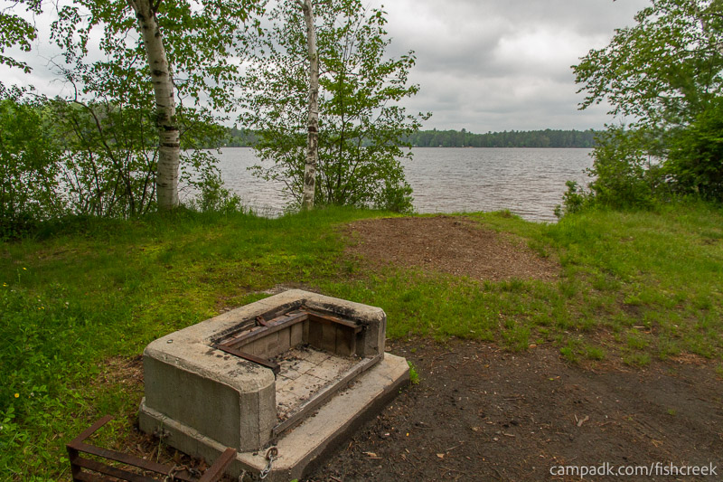 Campsite Photo of Site 69 at Fish Creek Pond Campground, New York - Fireplace View