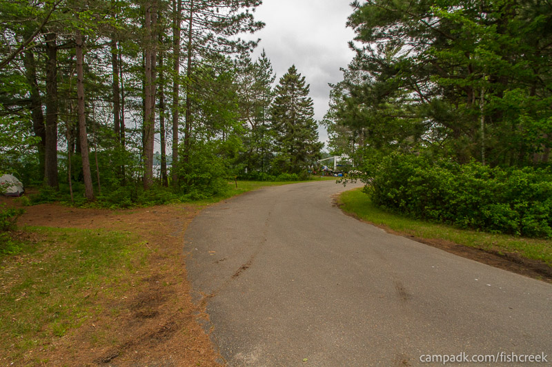 Campsite Photo of Site 66 at Fish Creek Pond Campground, New York - View Down Road from Campsite