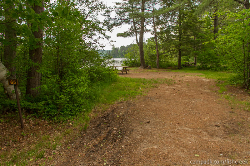 Campsite Photo of Site 65 at Fish Creek Pond Campground, New York - Looking at Site from Road Sign Visible