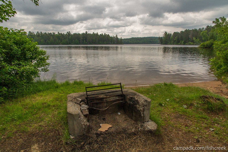 Campsite Photo of Site 65 at Fish Creek Pond Campground, New York - Fireplace View
