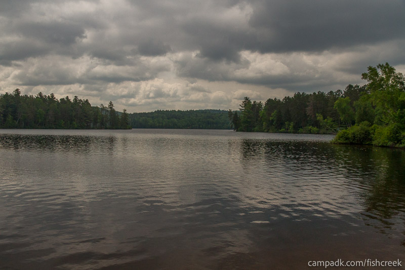 Campsite Photo of Site 65 at Fish Creek Pond Campground, New York - View from Shoreline