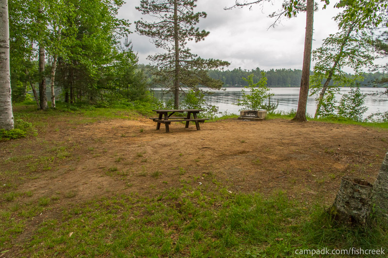 Campsite Photo of Site 54 at Fish Creek Pond Campground, New York - Looking at Site from Road