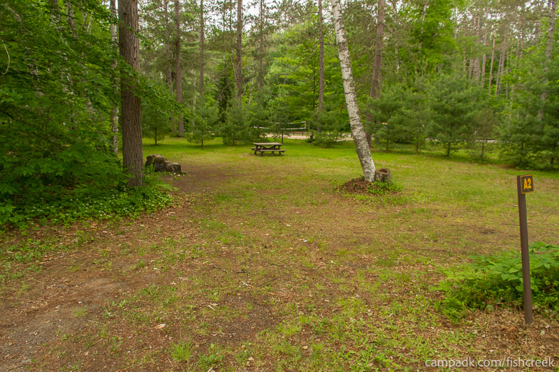 Campsite Photo of Site A2 at Fish Creek Pond Campground, New York - Looking at Site from Road Sign Visible