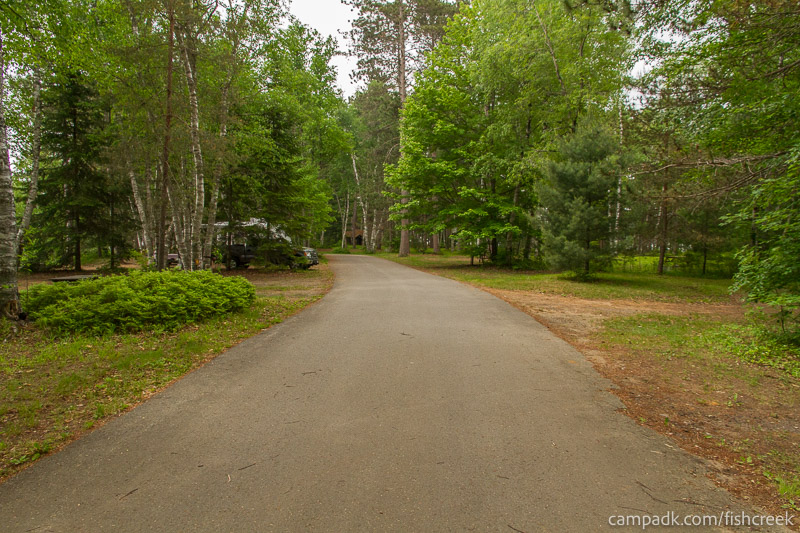 Campsite Photo of Site A2 at Fish Creek Pond Campground, New York - View Down Road from Campsite
