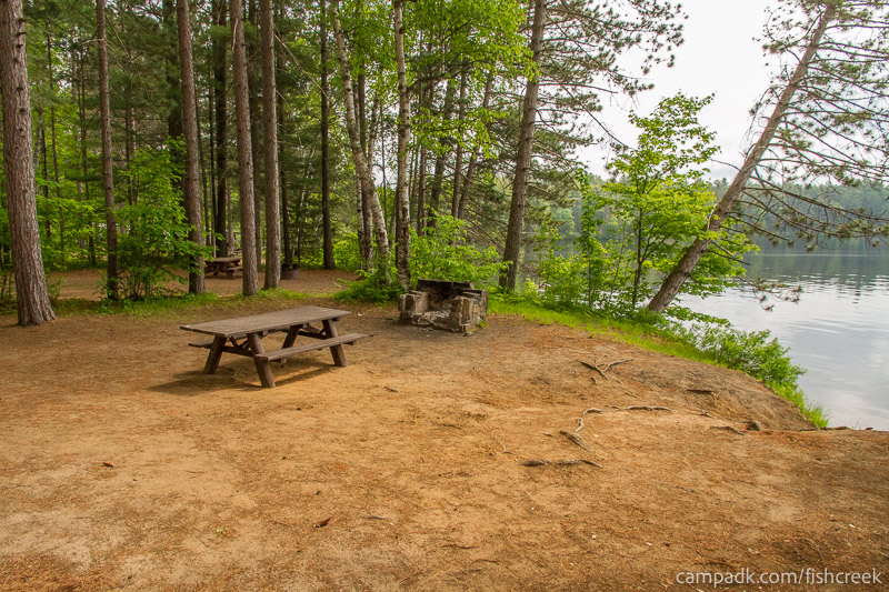 Campsite Photo of Site 46 at Fish Creek Pond Campground, New York - Cross Site View