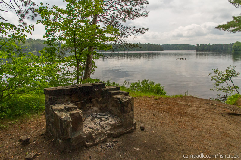 Campsite Photo of Site 46 at Fish Creek Pond Campground, New York - Fireplace View