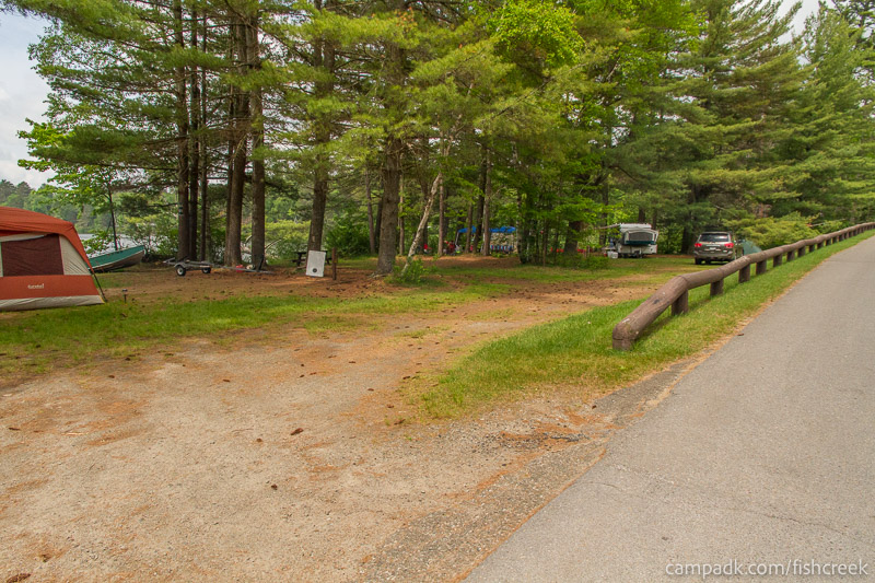 Campsite Photo of Site 33 at Fish Creek Pond Campground, New York - Looking at Site from Road Sign Visible