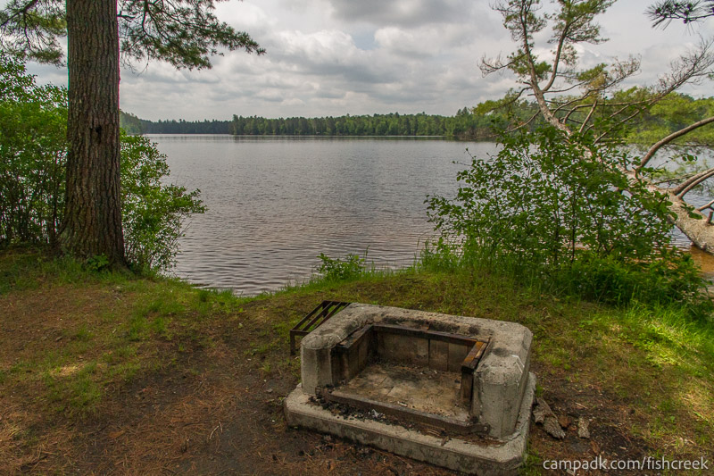 Campsite Photo of Site 33 at Fish Creek Pond Campground, New York - Fireplace View