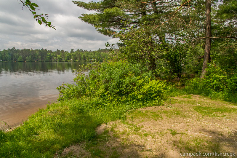 Campsite Photo of Site 28 at Fish Creek Pond Campground, New York - Cross Site View
