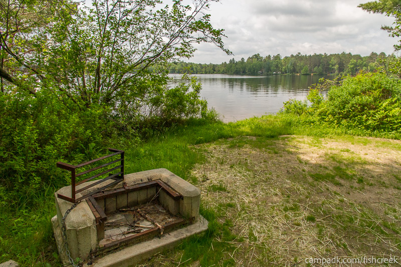 Campsite Photo of Site 28 at Fish Creek Pond Campground, New York - Fireplace View