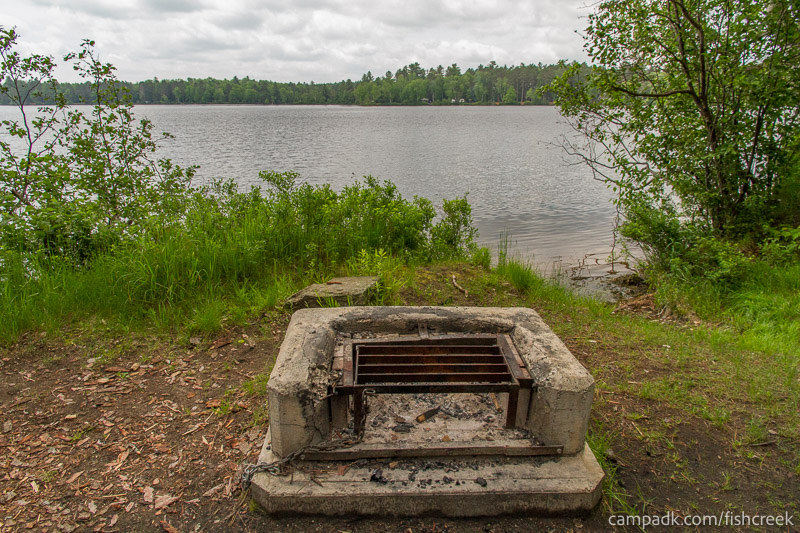 Campsite Photo of Site 26 at Fish Creek Pond Campground, New York - Fireplace View