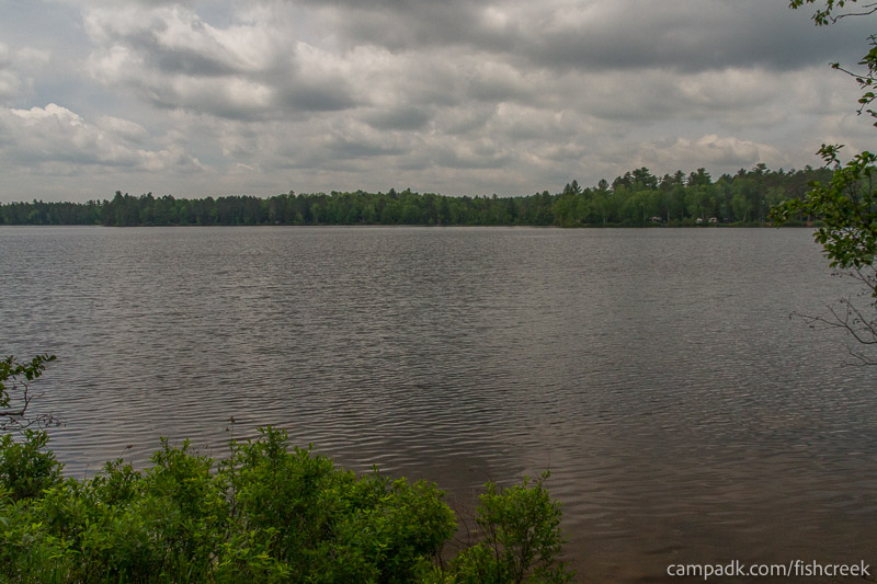 Campsite Photo of Site 26 at Fish Creek Pond Campground, New York - View from Shoreline