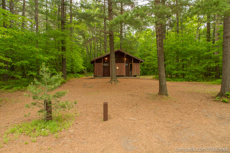 Campsite Photo of Site 26 at Fish Creek Pond Campground, New York - Washroom Across the Road