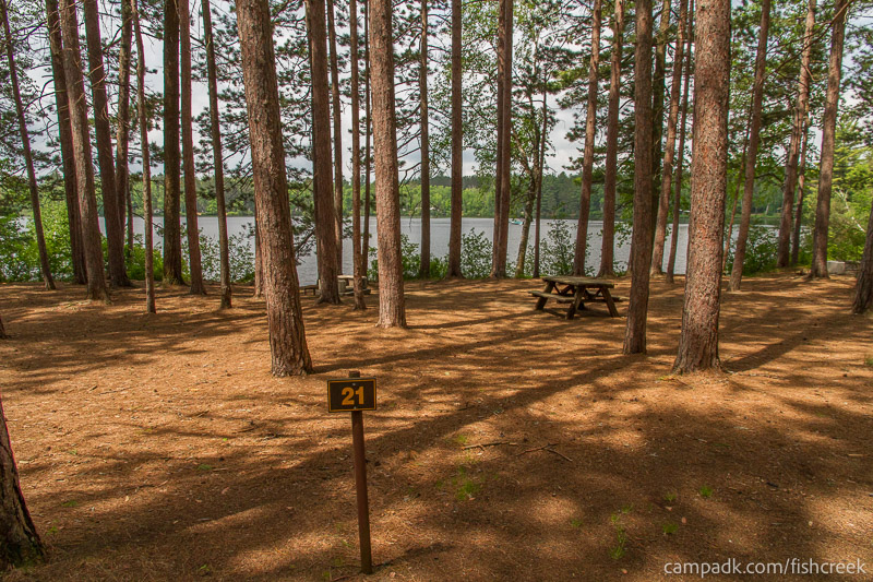 Campsite Photo of Site 21 at Fish Creek Pond Campground, New York - Looking at Site from Road Sign Visible