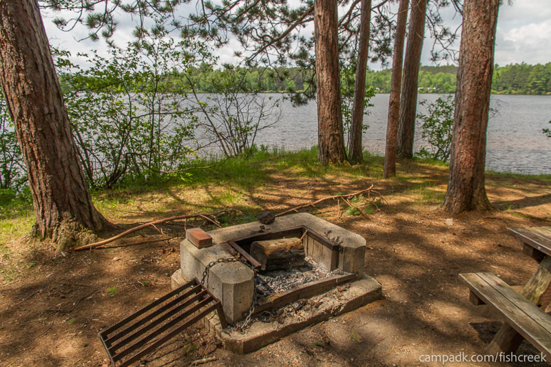 Campsite Photo of Site 16 at Fish Creek Pond Campground, New York - Fireplace View