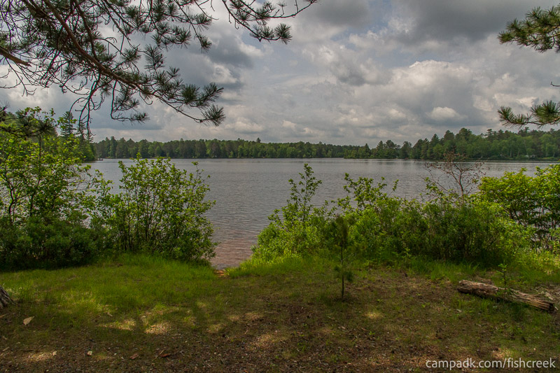 Campsite Photo of Site 13 at Fish Creek Pond Campground, New York - Shoreline and View