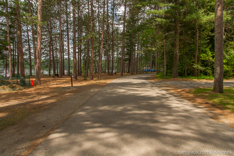 Campsite Photo of Site 13 at Fish Creek Pond Campground, New York - View Down Road from Campsite