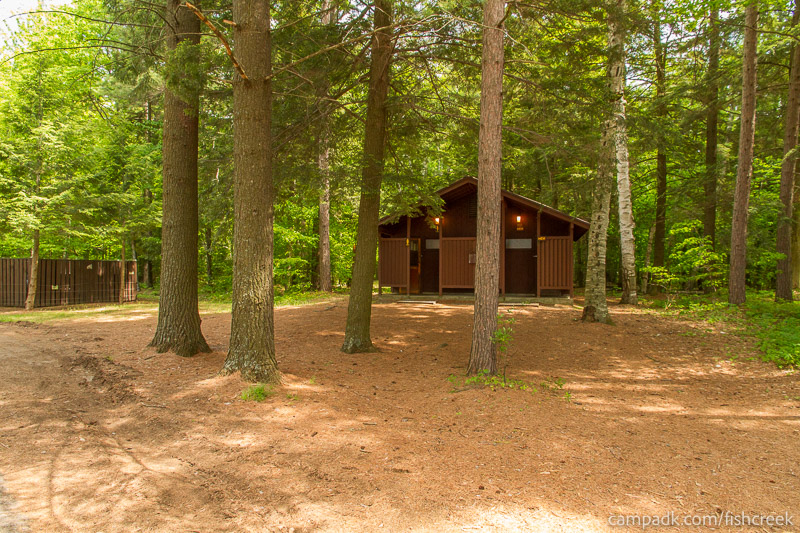 Campsite Photo of Site 12 at Fish Creek Pond Campground, New York - Washroom Across the Road