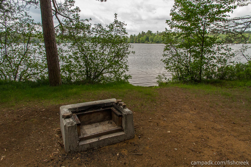 Campsite Photo of Site 10 at Fish Creek Pond Campground, New York - Fireplace View