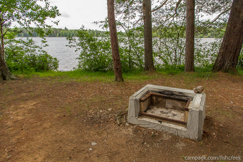 Campsite Photo of Site 9 at Fish Creek Pond Campground, New York - Fireplace View