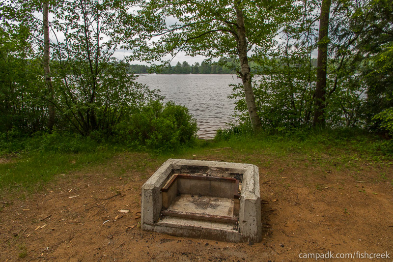 Campsite Photo of Site 7 at Fish Creek Pond Campground, New York - Fireplace View