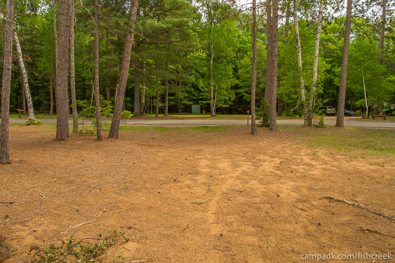 Campsite Photo of Site 7 at Fish Creek Pond Campground, New York - Looking Back Towards Road