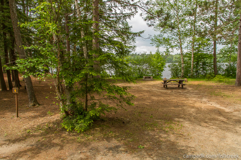 Campsite Photo of Site 6 at Fish Creek Pond Campground, New York - Looking at Site from Road Sign Visible