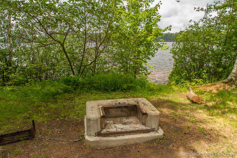 Campsite Photo of Site 6 at Fish Creek Pond Campground, New York - Fireplace View